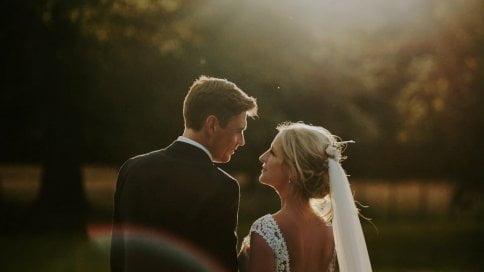 New wedd couple having a photo shot during beautiful sunset