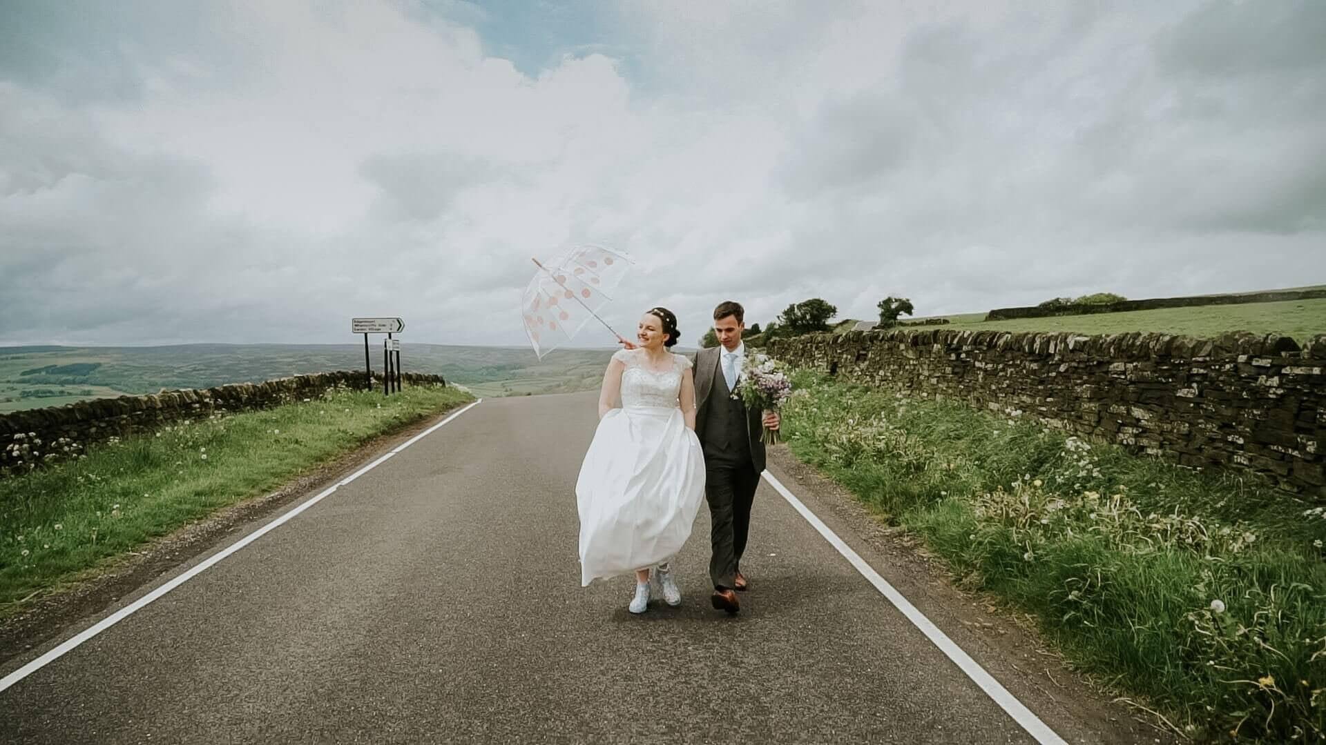 Groom and Bride walking down the road in Peak District