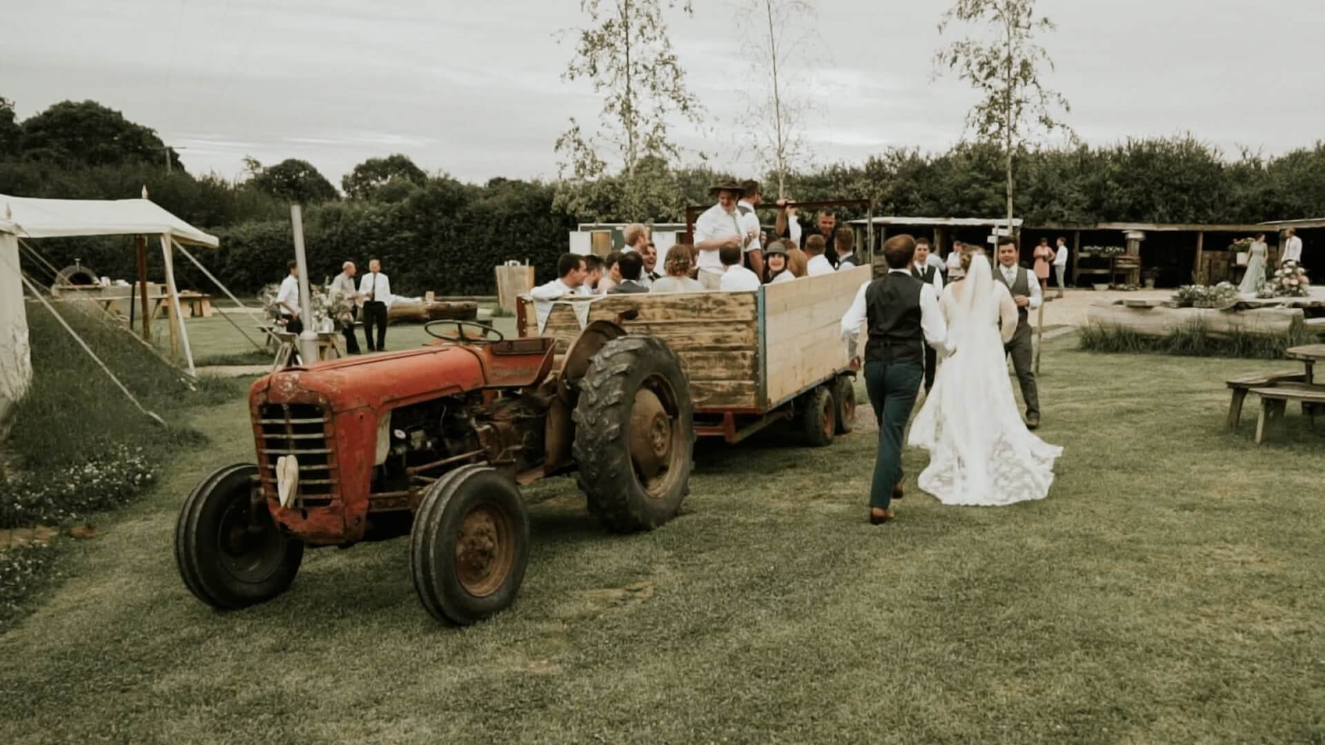 Wedding couple having a tractor ride during reception