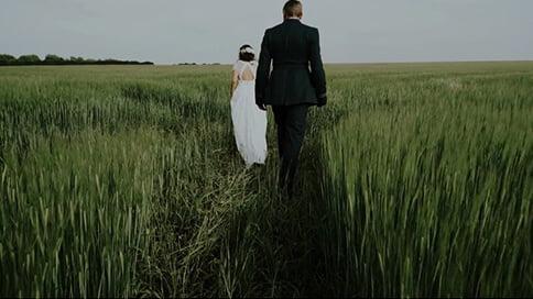 Couple walking on the field around Inkersall Grange Farm
